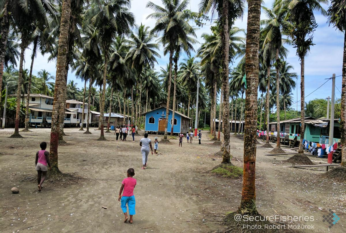 Children gather in Punta Bonita's village square. - Photo by Robert Mazurek