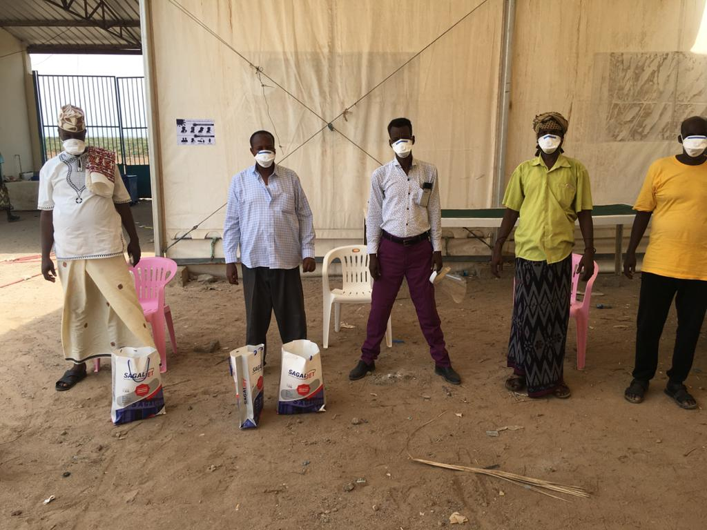 Community members in Zeila, Somaliland show how to properly wear masks and personal protection equipment. Co-management, COVID-19 information, Fisheries.