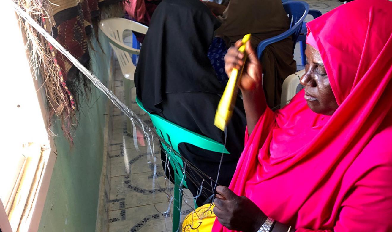 Somali women net mending making